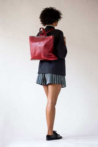 red backpack navy blazer striped shorts