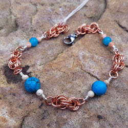 Turquoise-dyed Howlite with Copper Double Spiral
