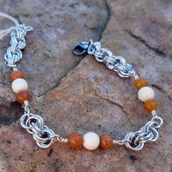 Bone and Orange Stone with Double Spiral