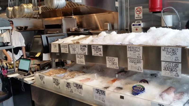 The fresh fish on display will make you hungry when you walk in.
