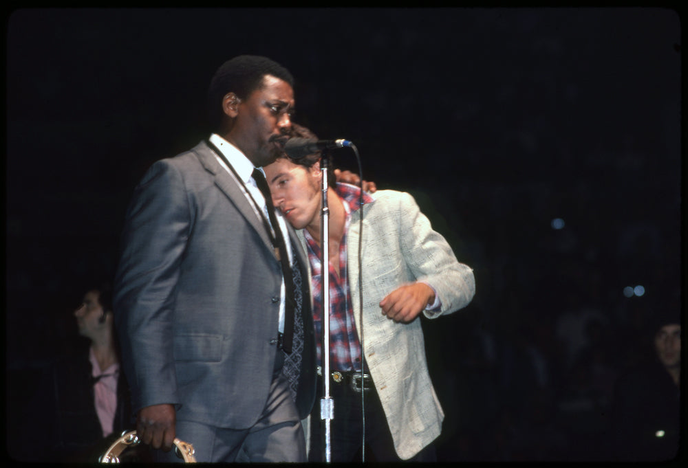 Springsteen being Comforted by Clarence Clemons