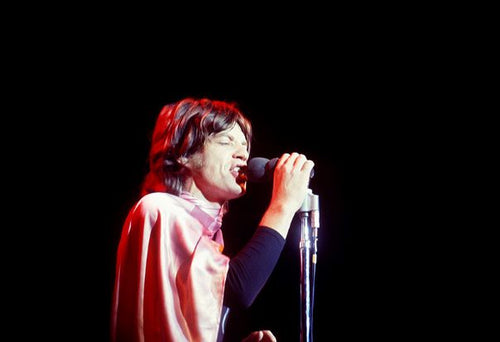 LIVERMORE, CA - DECEMBER 6: English singer, songwriter, actor, and film producer Mick Jagger of the English rock band The Rolling Stones performs during the Altamont Speedway Free Festival, which was a counterculture rock concert held on Saturday, December 6, 1969, at the Altamont Speedway in Livermore, California. (Photo by Jeff Hochberg/Rock Negatives)