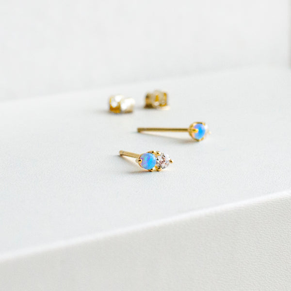 Tiny double stone stud earrings