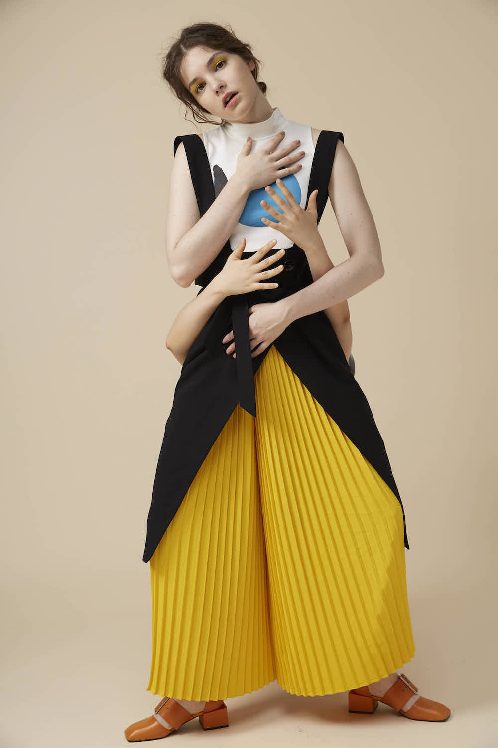Yellow pleated pants