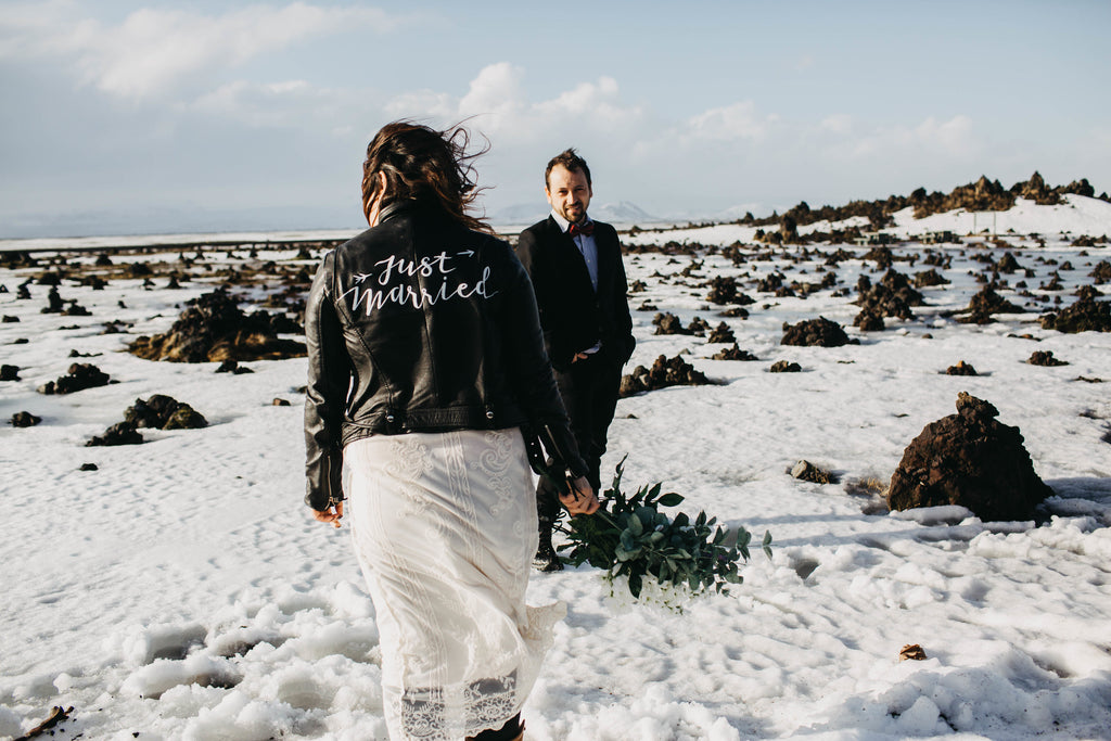 A bride wearing #TheJustMarriedJacket after her gorgeous elopement in Iceland.