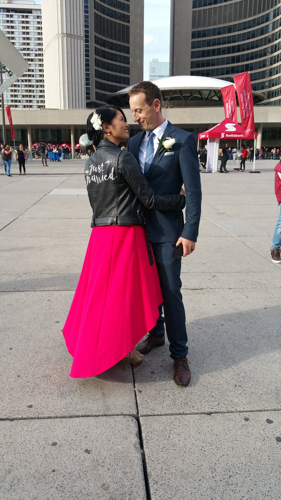 A Toronto City Hall Wedding with a newly married couple featuring #TheJustMarriedJacket.