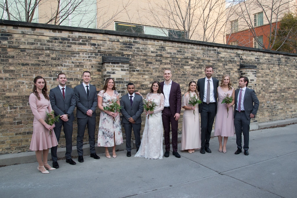 A wedding party poses for a photo on Queen St West in Toronto.