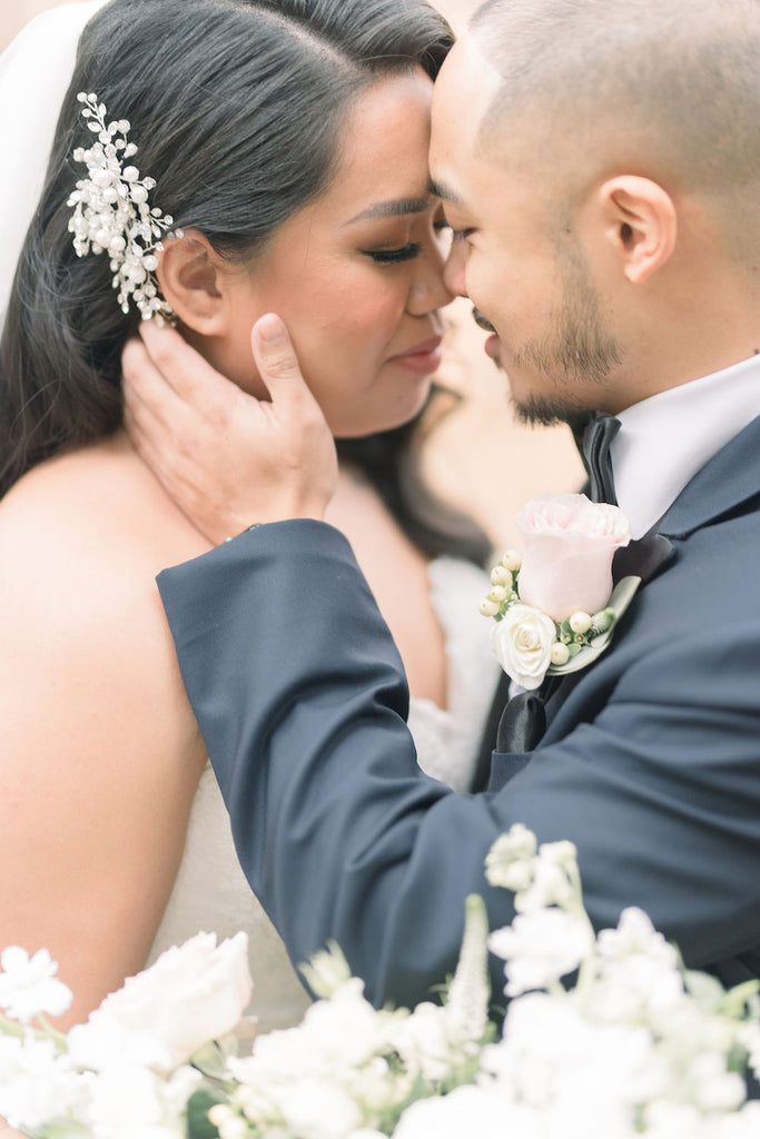 A happy couple kisses after getting married.