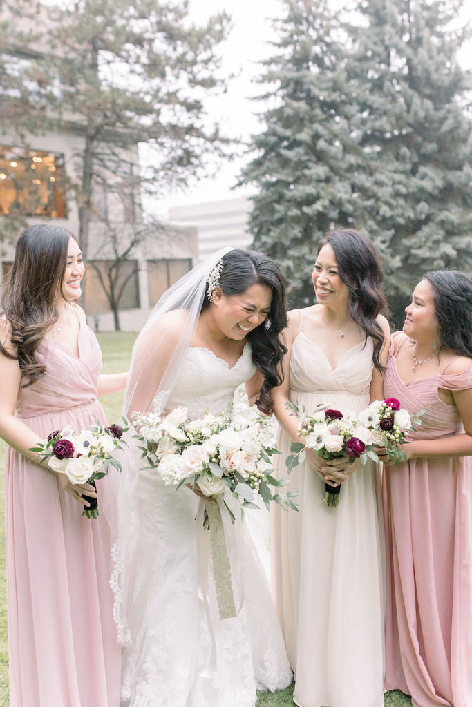 A bride and her bridesmaids share a laugh before the ceremony.