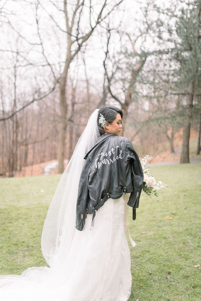 A bride wears #TheJustMarriedJacket.