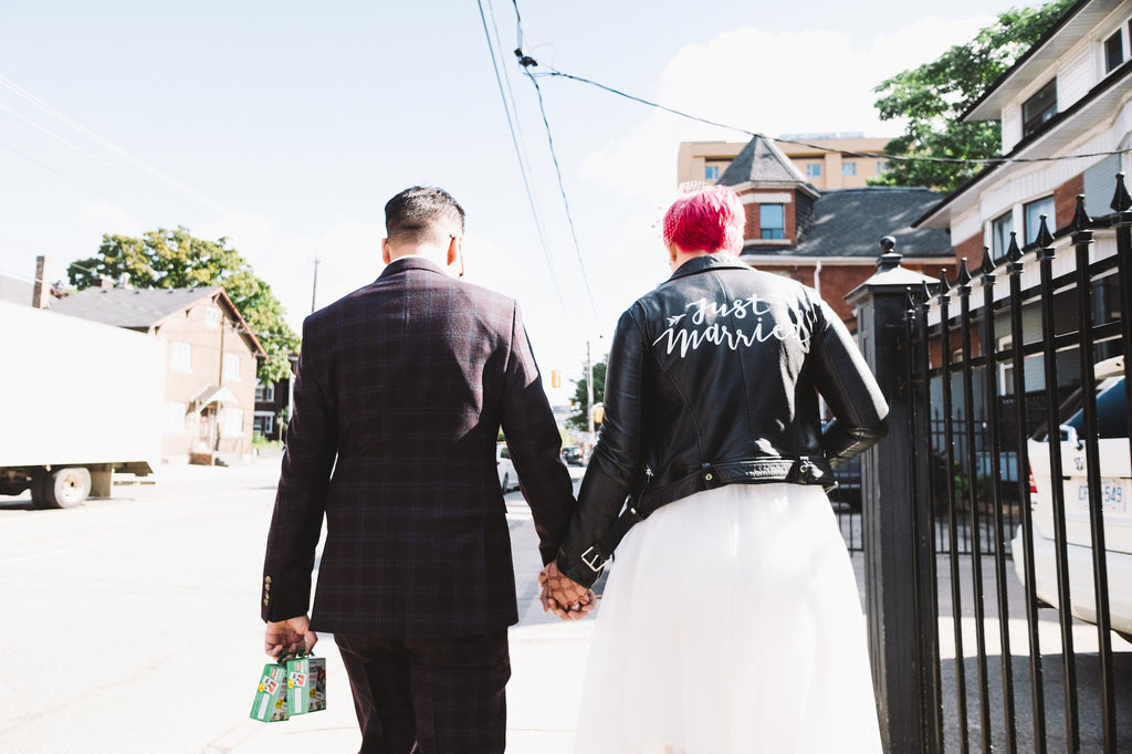 An alternative Toronto couple walks to the subway to go get married.