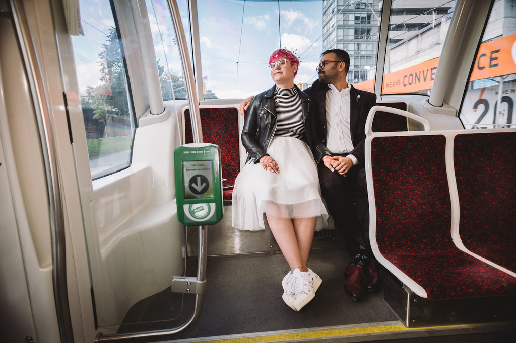 Toronto couples takes the subway to their wedding reception.