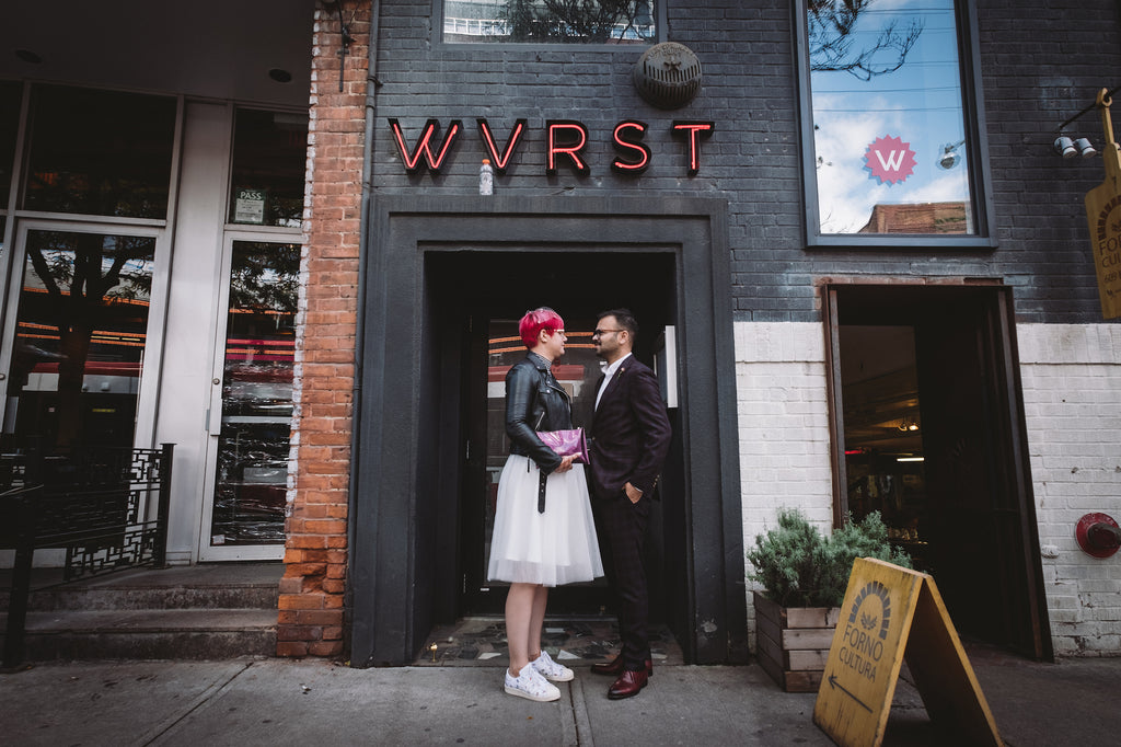 Wedding reception at Wvurst Toronto with couple standing in front of the venue.