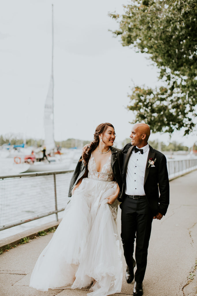 A bride and groom by Lake Ontario on Toronto's lake front.