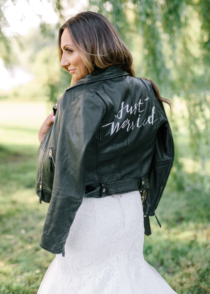 A Toronto bride wearing #TheJustMarriedJacket.