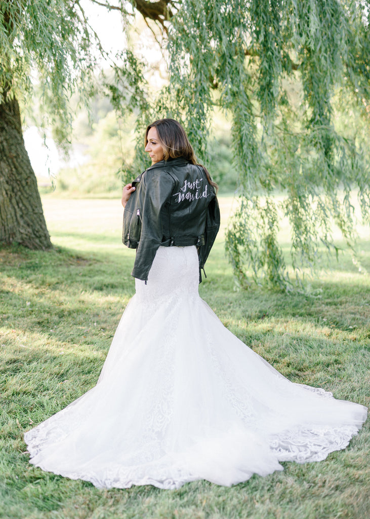 Modern bride wearing a sexy leather jacket on her wedding day.