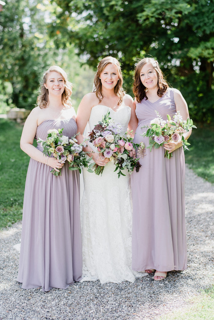 The bride poses with her bridesmaids.
