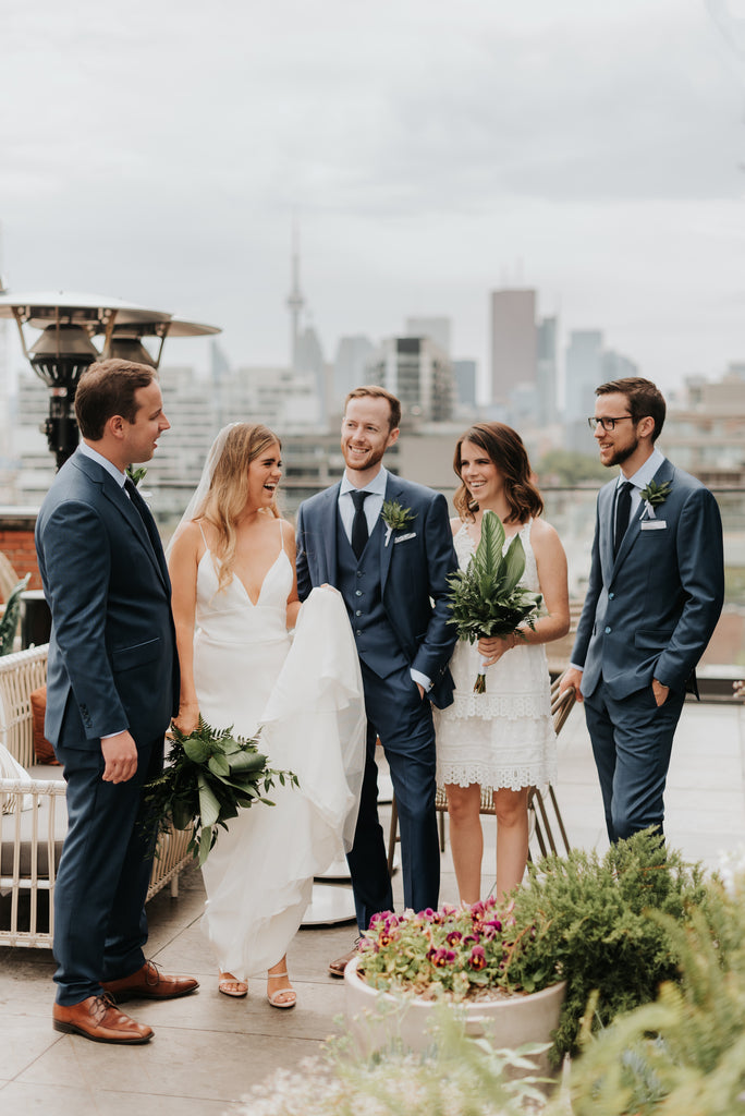 Gorgeous, minimal wedding in Toronto with the CN Tower in the background.
