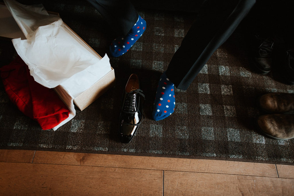 A groom gets his shoes ready.