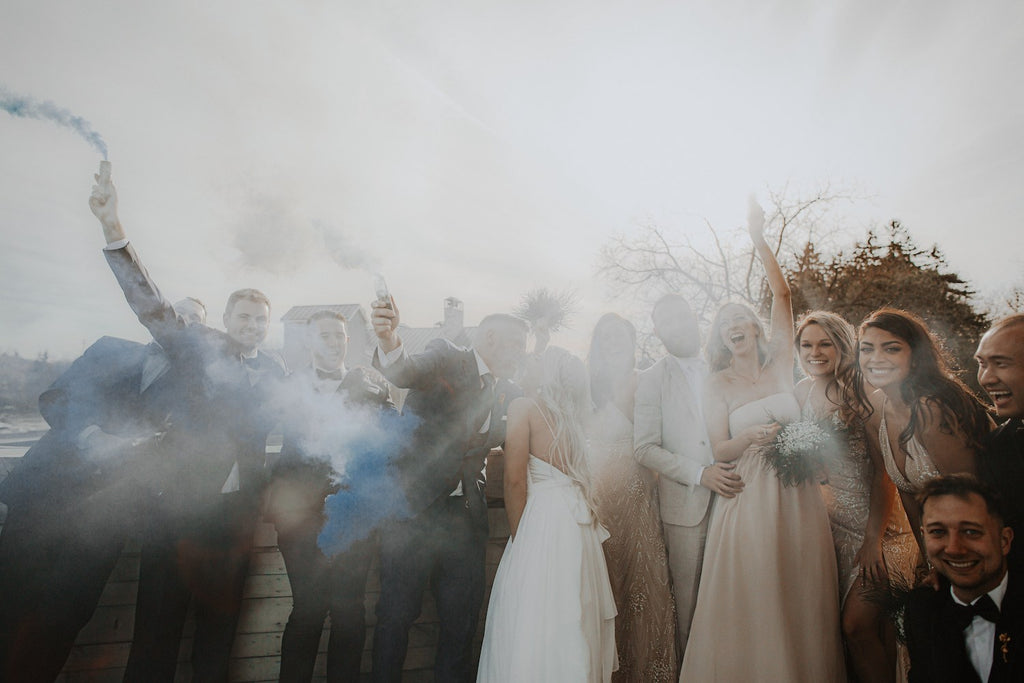 A wedding party sets off smoke bombs for the big day.