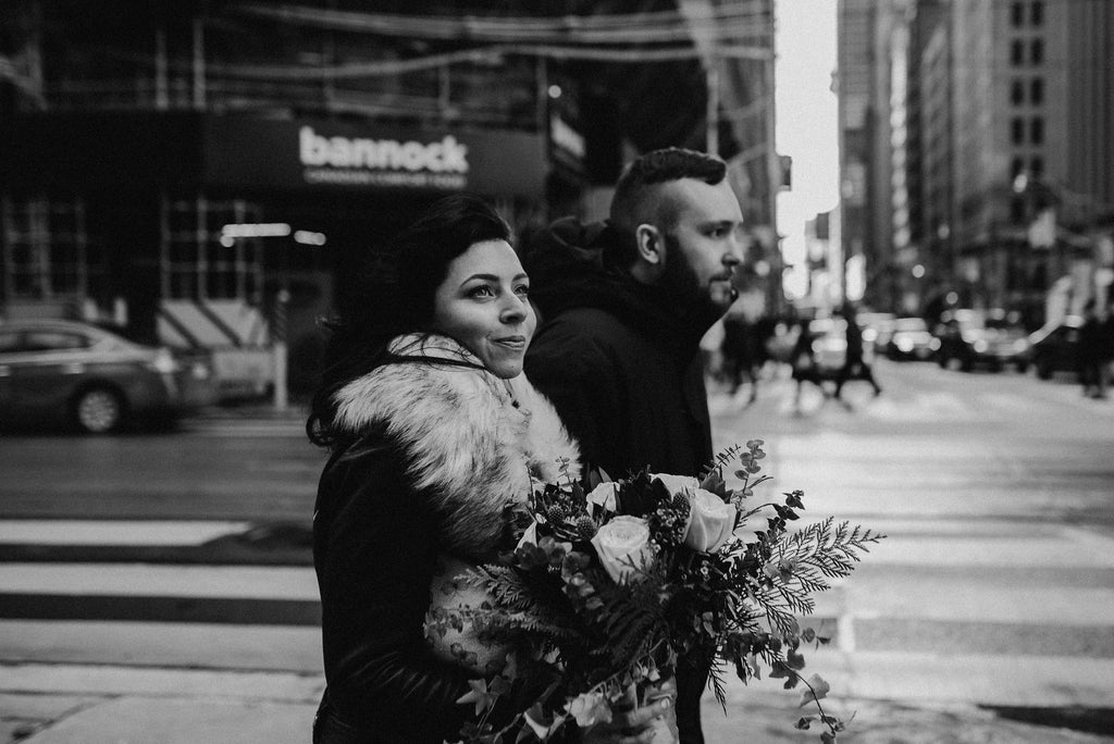 A black and white photo of a couple about to elope in the city of Toronto.