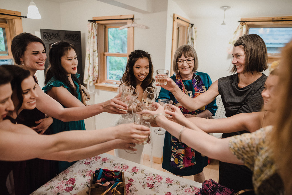 Boho, eclectic bridal party saying cheers before the reception.