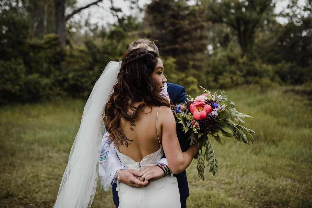 Boho bride with a beautiful, colorful bouquet. Boho wedding Toronto.