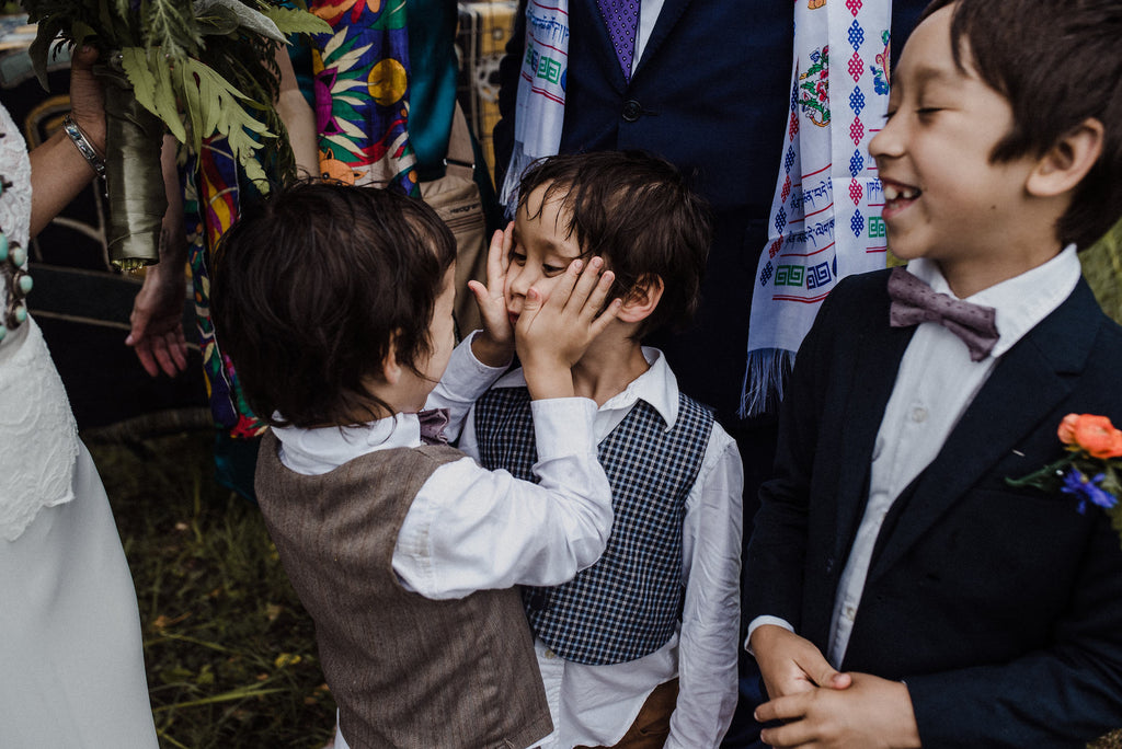 Children at a boho wedding.