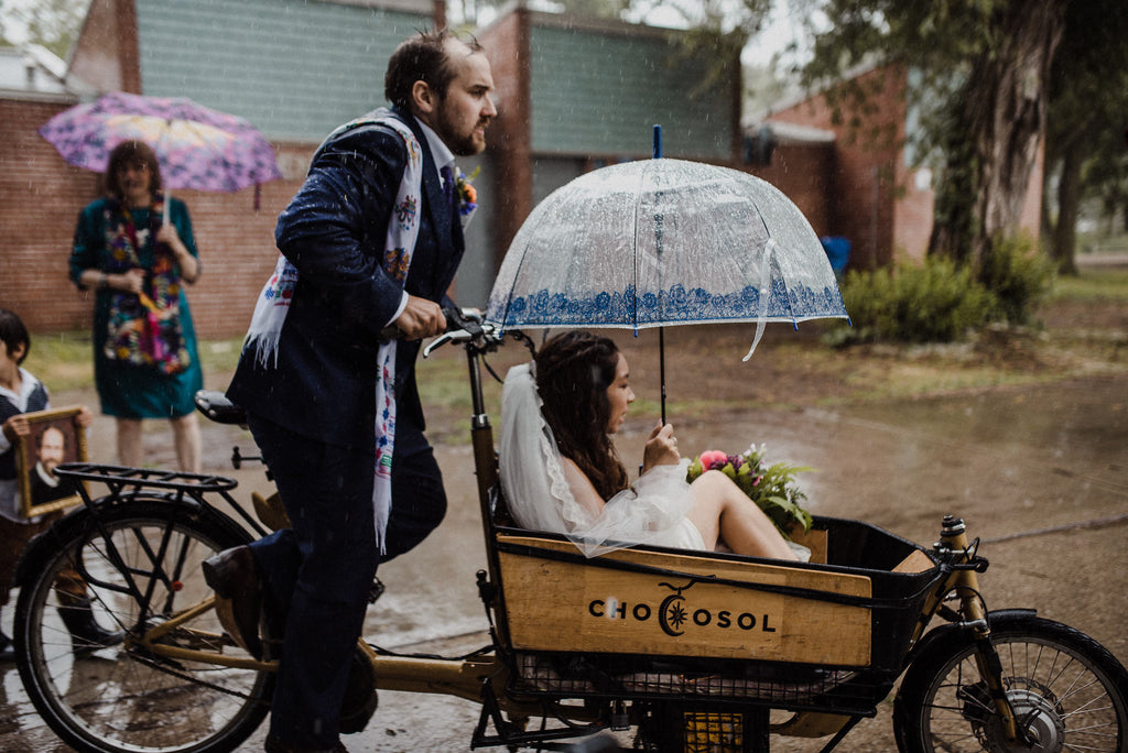 A Toronto couples bikes into their boho wedding venue on Ward's Island.