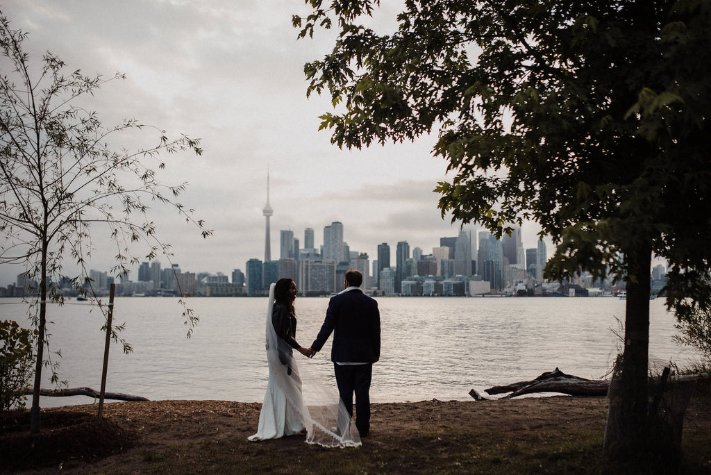 A newly wed couple in front of the Toronto skyline.