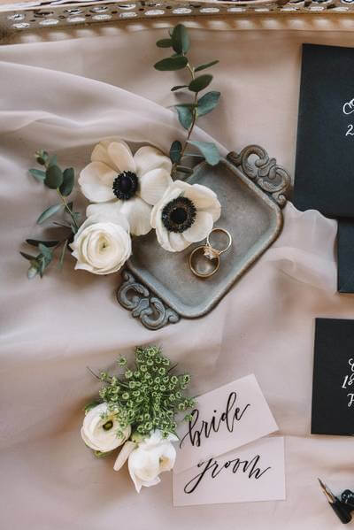 White anemones pictures with beautiful wedding stationary from Via Calligraphy.