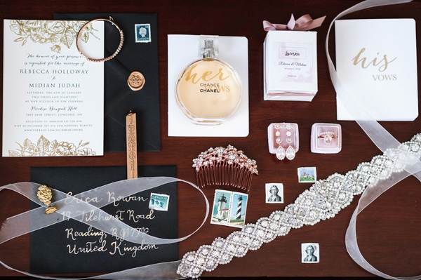 A flatlay of a glamorous bride's belongings.