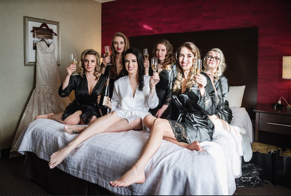 A glamorous bride and her bridesmaids toast on her big day.