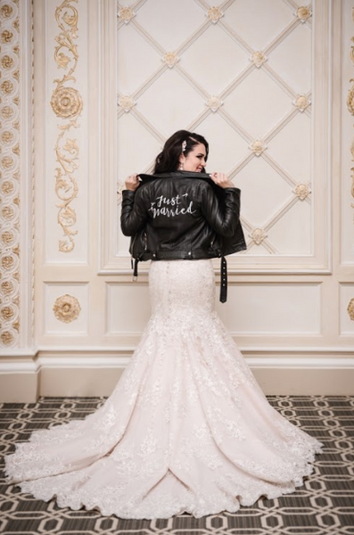 The bride shows off her look featuring #TheJustMarriedJacket.