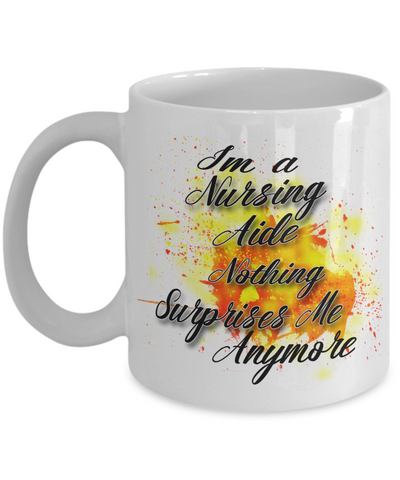 "Gift for Nursing Aides   ""I'm a Nursing Aide nothing surprises me anymore"" Novelty Coffee Mug Gift for Nursing Aide"