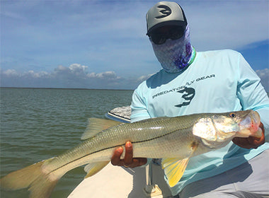 Captain Zapata with Snook fly fishing for predators