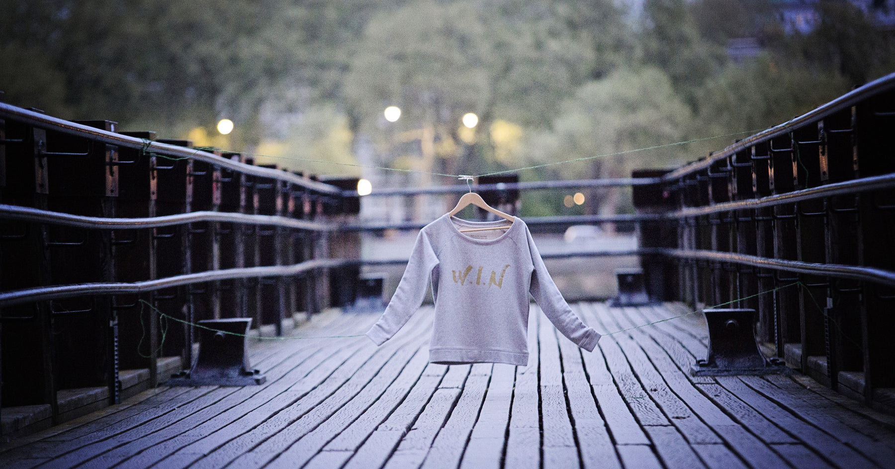 Image of sweatshirt on a jetty over the river Thames.
