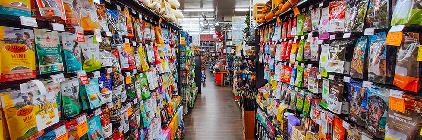 image of store aisles with dog and cat food stocked on shelves