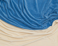 folds of blue and ivory organic cotton fabric swirled together