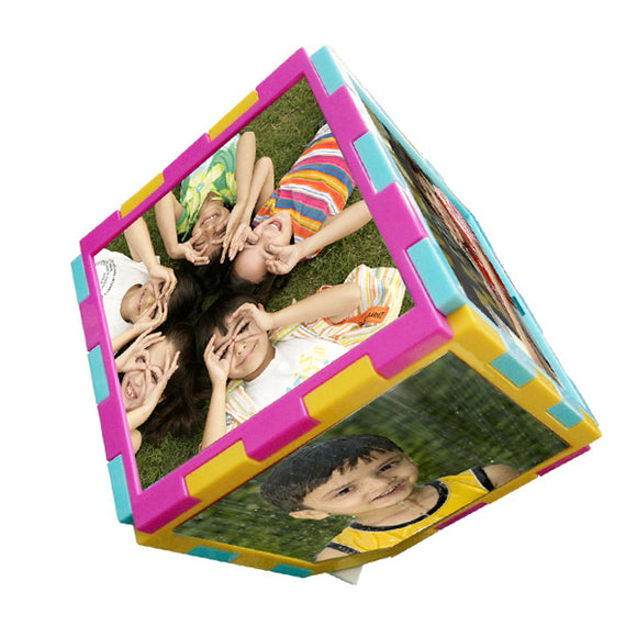 This amazing Revolving Photo Cube will have your favorite moments in motion! Showcase your beloved memories with 6 pictures rotating in a photo cube which appears to magically spin on its own. Why have a plain, ordinary frame when you can have a unique turning cube displaying 6 pictures instead of one. It will also make a great conversation piece for your home or office.