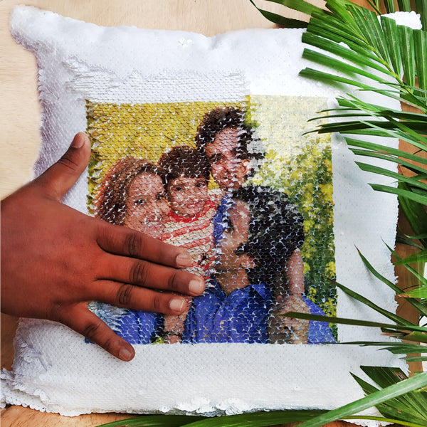 These magic pillows are a layer of sequins with an image printed on one side, by moving the sequins one way the image is hidden and a quick swipe the other way reveals the image! The white side contains the image and the other color is when the image is hidden
