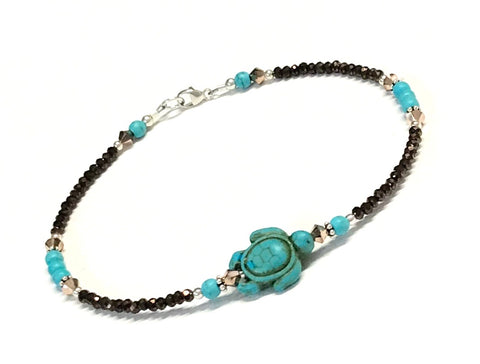 Beaded sea turtle anklet in the colors of turquoise and bronze