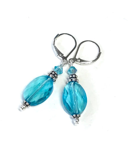 Oval crystal earrings in the color of light turquoise and sterling silver leverbacks