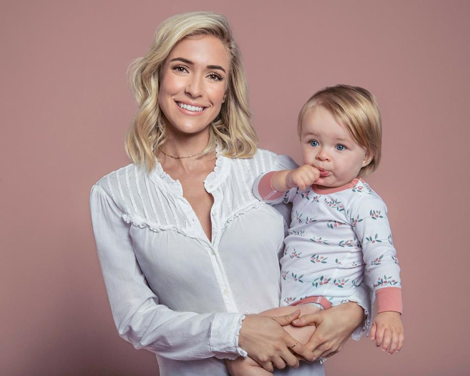 Kristin Cavallari with baby wearing the new Sapling Child organic babywear collection