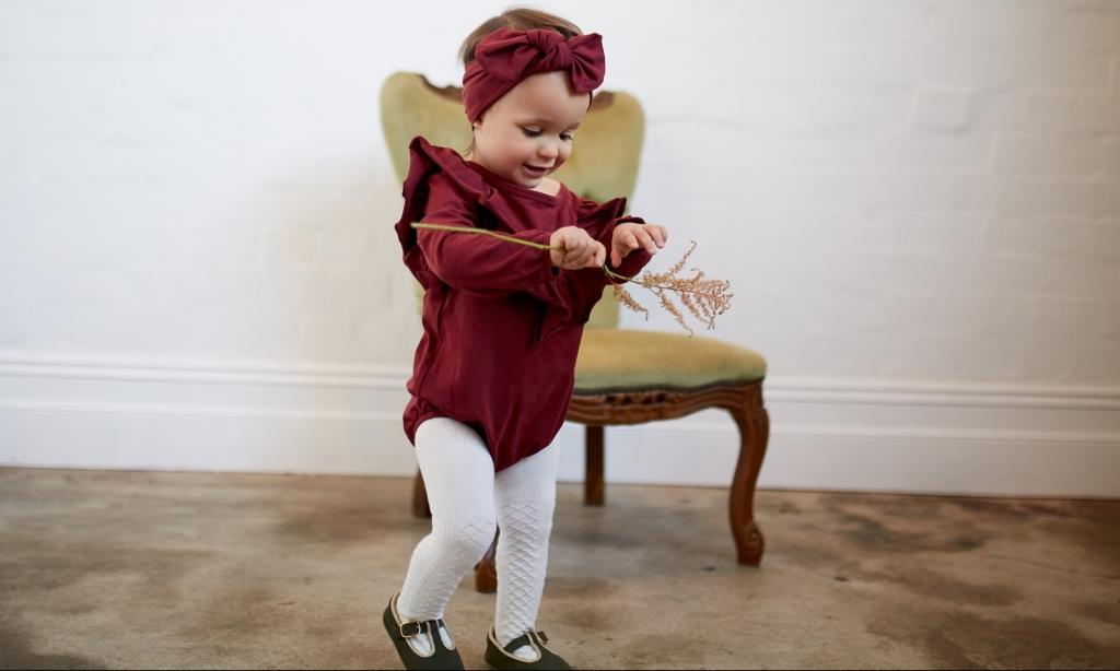 mad about mini ruby red long sleeve baby romper with frill sleeves