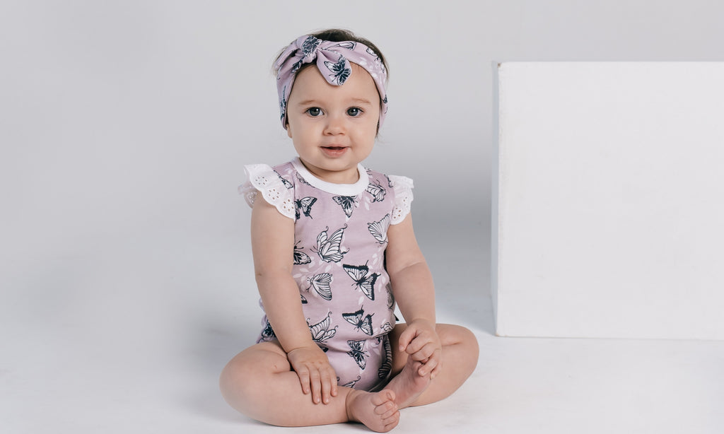 aster & oak lavender organic baby onesie with butterfly print