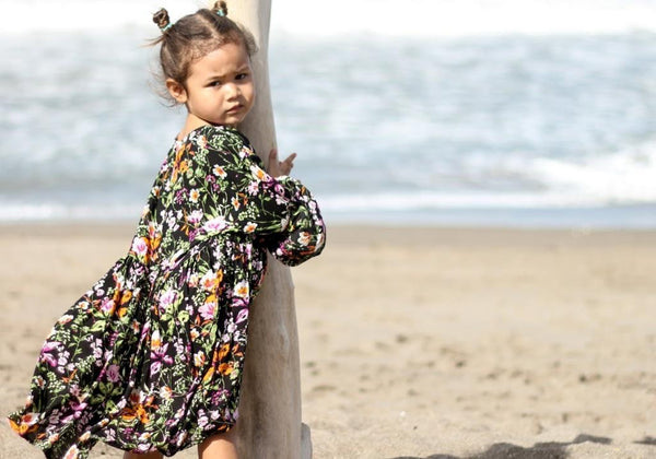 girl wearing melatiku long sleeve tropical floral girls dress