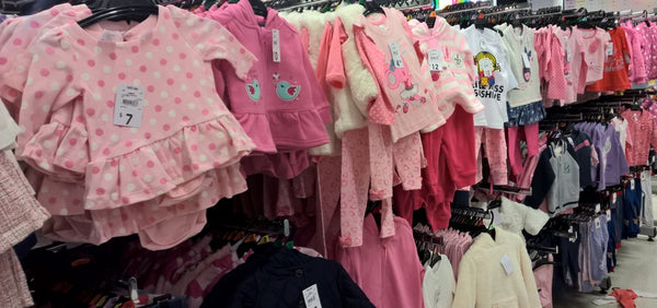 too many pink baby clothes in a department store