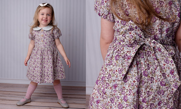 girl wearing poppy harper the label purple floral dress by poppy harper the label