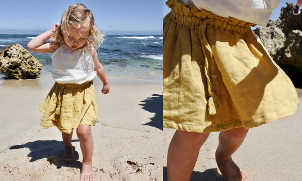 girl on beach wearing le edit sunshine skirt and blanc marni singlet